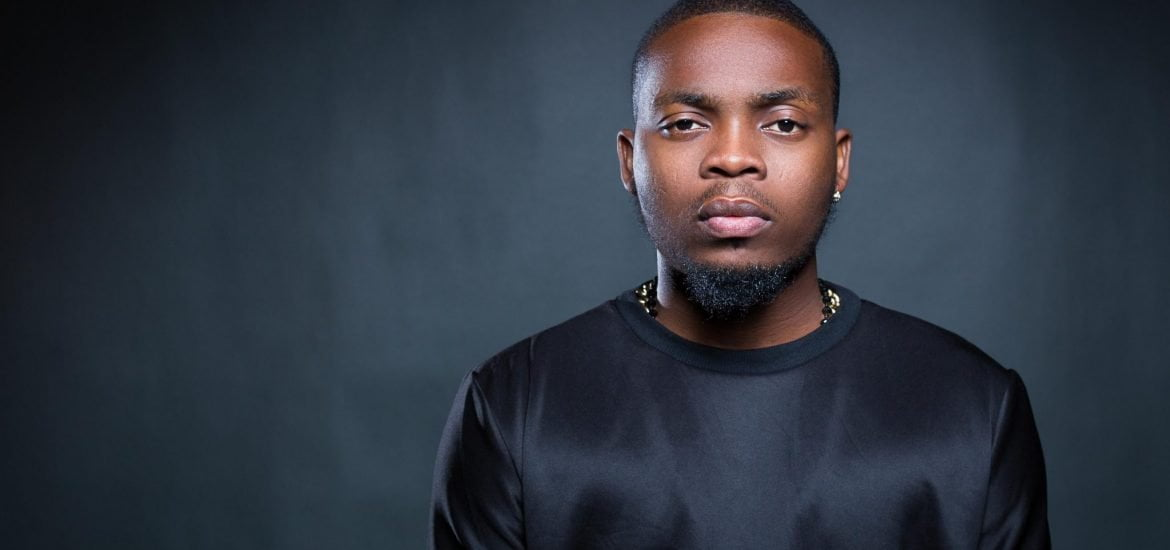 Lady Attacks Olamide in Germany